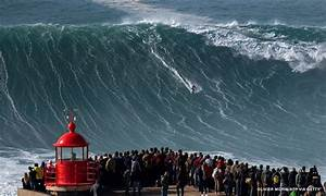 big wave surfers wrestle with to feed addiction thrill