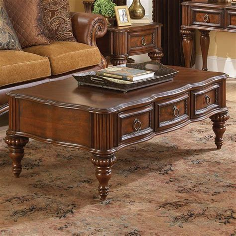 Bright and stylish, this living room features sophisticated furnishings and decor. Prenzo Cocktail Table   Coffee table, Accent table decor, Tuscan table