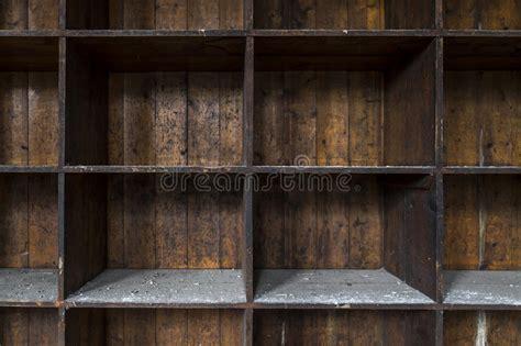 distressed empty wooden storage shelves stock photo