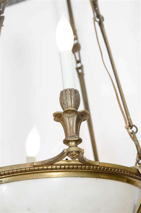 an antique bronze and alabaster light fixture at