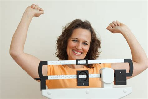 mature woman celebrating weight loss   medical weight
