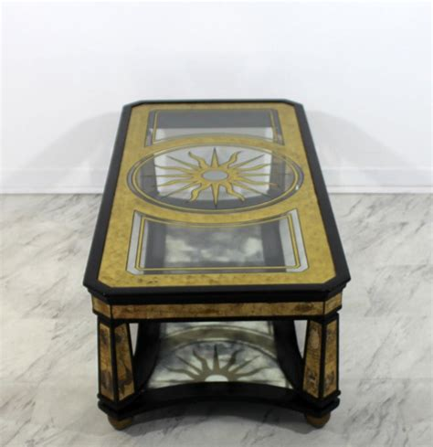 Accent your living room with a coffee, console, sofa or end table. Mid-Century Modern Hollywood Regency Black Wood Sun Painted Glass Coffee Table For Sale at 1stdibs