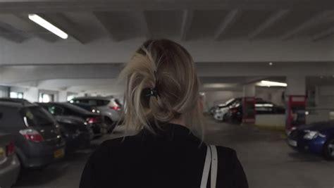 Frau In Garage by Parking Stock Footage