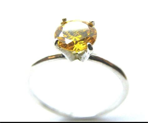 solitaire ring  yellow stone  sterling silver