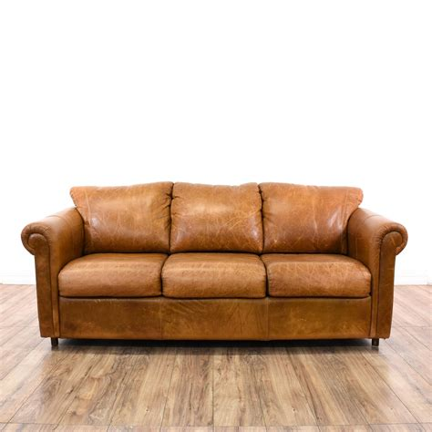 Distressed Leather Sleeper Sofa by This Sofa Bed Is Upholstered In A Camel Colored Distressed