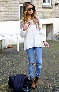 Loose sweater ripped light wash jeans and softly curled hair Fall Outfit #clothesforwomen # ...