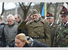 Latvian Nazi veterans join controversial annual march
