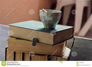 Closeup Of Healthy Herbal Cup Of Tea At A Pile Of Old Dusty Books Stock Photo - Image of moody ...