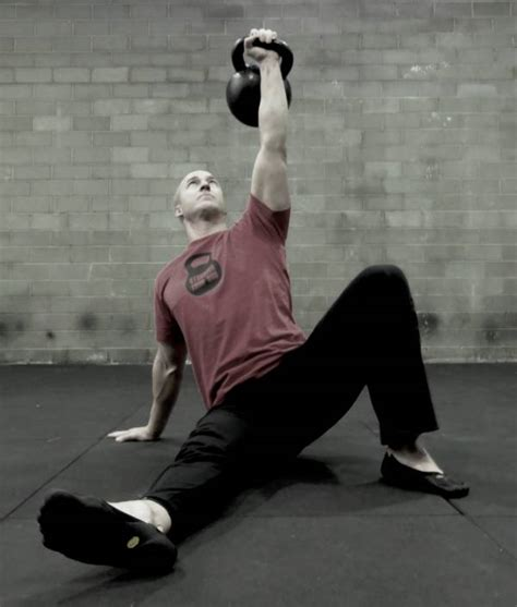 kettlebell snatch turkish kettlebells bruce lee exercises exercise ironman training perfect supersets ups andrew articles read breakingmuscle muscle strength breaking
