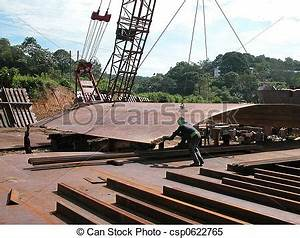 Stock Images of Shipyard - Workers unloading steel plates ...