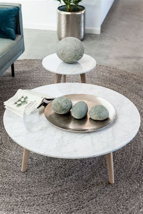● light grey top authentic marble swirls, lines and veining. round-marble-coffee-table-with-solid-oak-legs - HomeMydesign