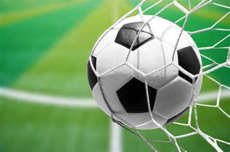 soccer ball  goal net  soccer field background photo