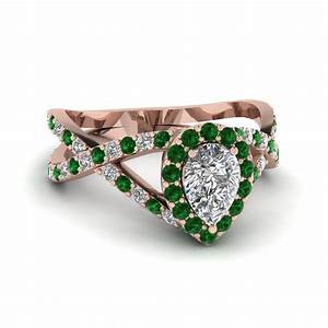 Pear shaped diamond engagement ring with green emerald in for Emerald green wedding ring