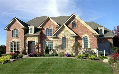 brick with light accents exterior materials