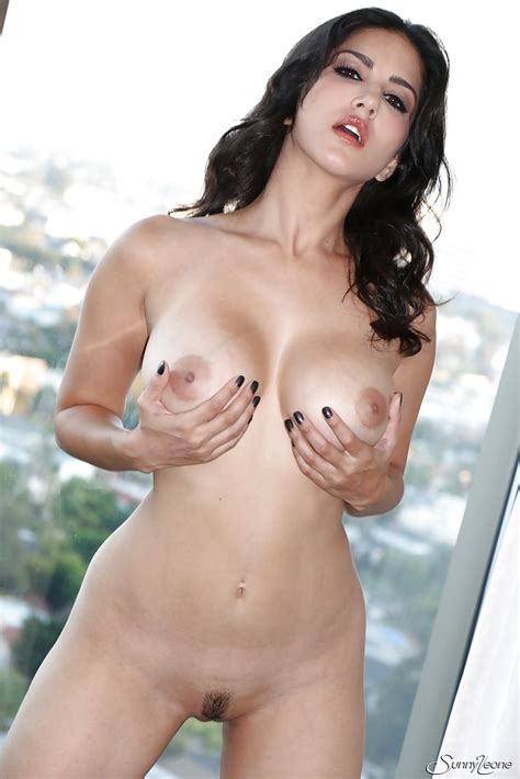 Curly Haired Brunette Sunny Leone Is Playing With Her Anal
