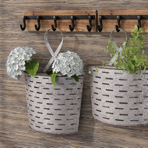 Beautiful pieces , did not have the blue as pictured ,but painted over several pieces and frame to make other decor. 2 Piece Parla Galvanized Wall Pockets Original Painting Set & Reviews | Birch Lane