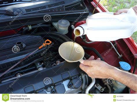 Adding Motor Oil To Car Royalty Free Stock Photos