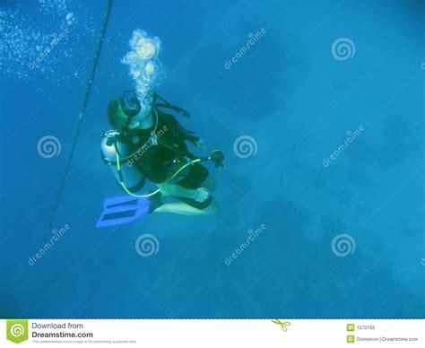 scuba diver blowing bubbles underwater royalty  stock