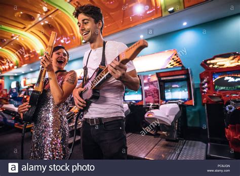 Playing Arcade Games Stock Photos And Playing Arcade Games