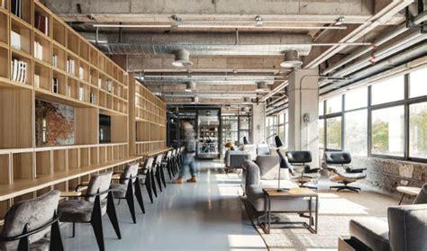 industrial office features exposed bricks concrete ceilings