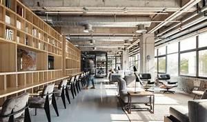 Industrial Office Features Exposed Bricks & Concrete Ceilings