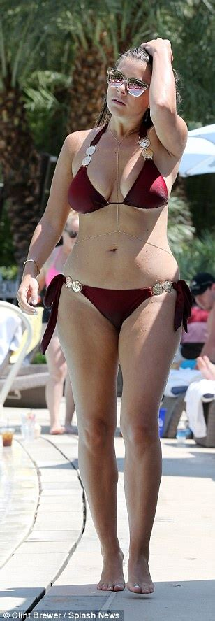 Imogen Thomas flaunts ample bust and posterior in skimpy ...