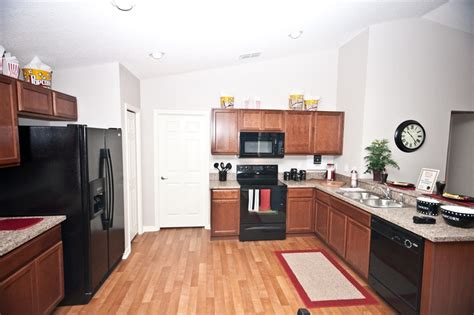 black laminate kitchen cabinets open kitchen with affordable style wood vinyl flooring 4728