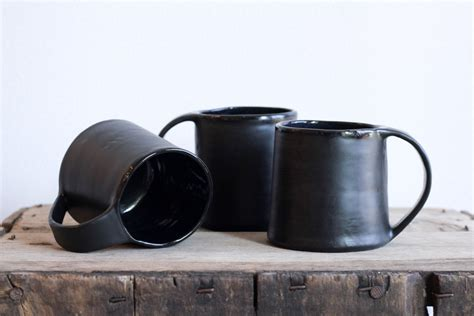 Choose from thousands of chaplin coffee cups designed by our community of independent artists and iconic brands. coffee mug   black   organic   modern   minimal by cravestudio on Etsy   Mugs, Organic modern ...