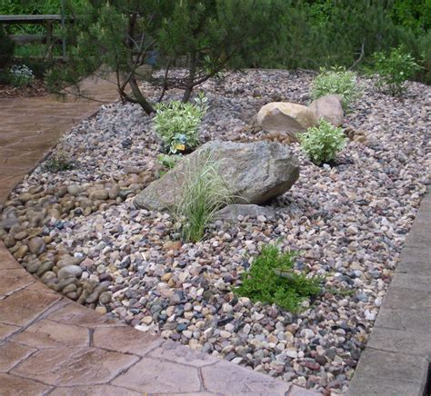 landscaping with rocks boulders feature rocks bubblers whitemud landscaping and garden center edmonton