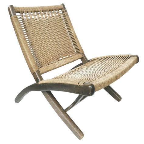 mid century folding rope chair in the style of hans wegner