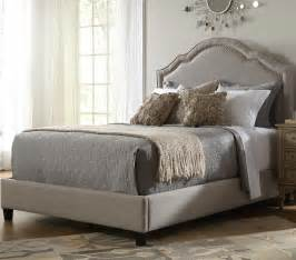 shaped nailhead fabric upholstered bed in taupe humble abode