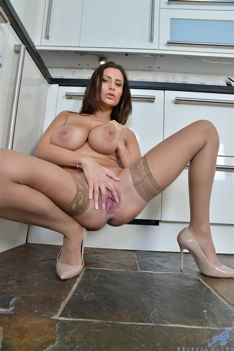 bustyy milf in stockings and high heels spreading pussy