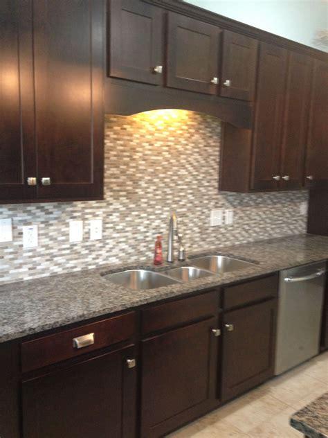 dark cabinets caledonia granite stone tile backsplash
