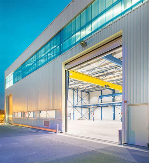 eclairage exterieur batiment industriel conception construction par design build groupe briand