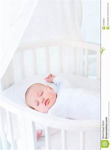Little Newborn Baby Boy Sleeping In White Round Crib Stock ...