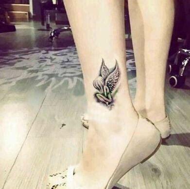 tattoo ange kolawi