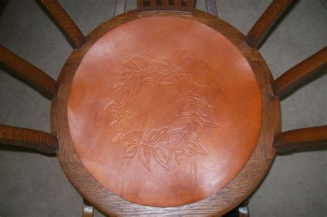 buy a crafted antique rocker that had leather seat