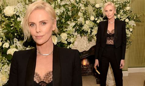 BAFTAs 2020: Charlize Theron wears trouser suit at after ...