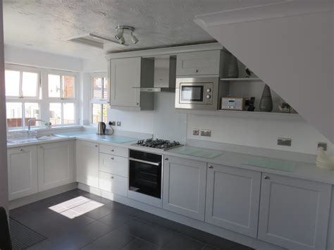 Light grey beaded Shaker kitchen. The Gallery Fitted