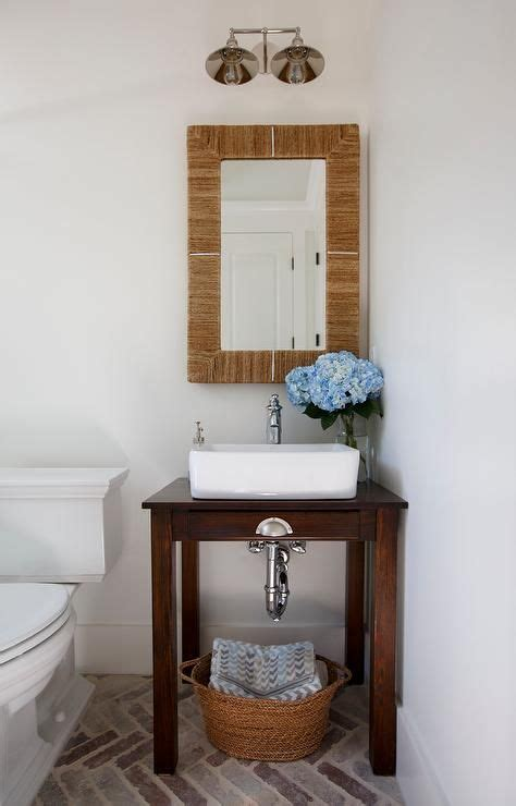 chic cottage powder room features  small console table