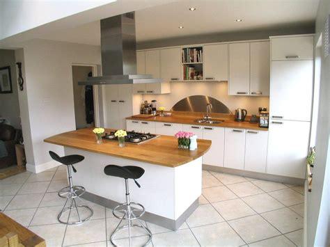white kitchen  oak worktop minimalism