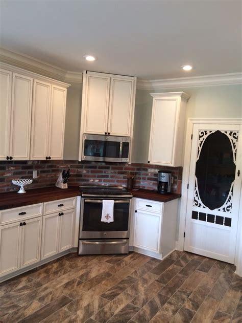 kitchen  brick paver backsplash ceramic wood floors