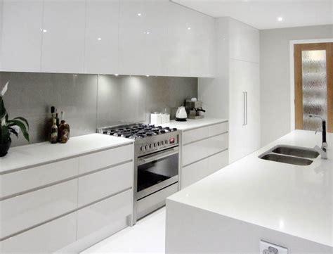 splashback ideas white kitchen white cupboards no handles light grey splashback all in