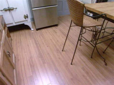 how to lay laminate flooring in a kitchen how to install laminate flooring hgtv 9783