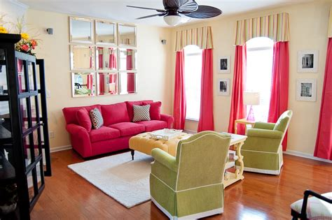 black and green rug pink sofas an touch of color in the living room