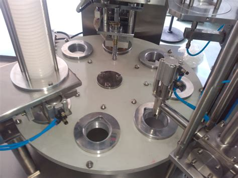 cream cups filling sealing machine rotary model yx  finished manufacturing  usa customer
