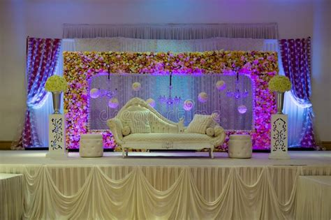purple themed wedding stage decorations stock image