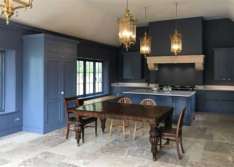 Stone flooring for a navy blue kitchen   Natural Stone