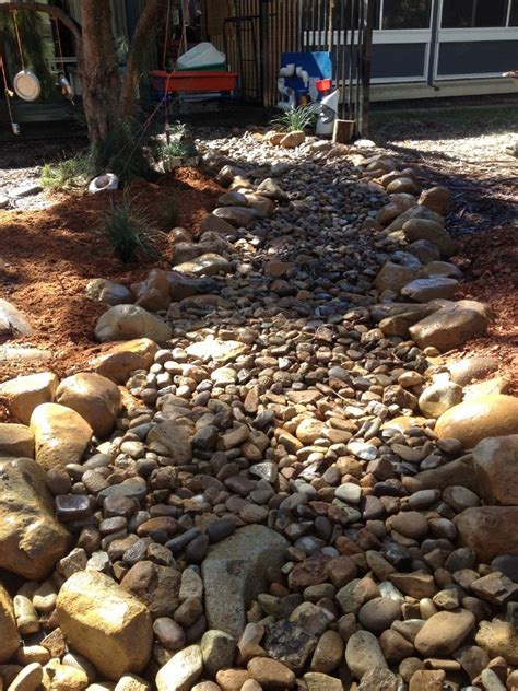 natural playgrounds creating  dry creek bed nature