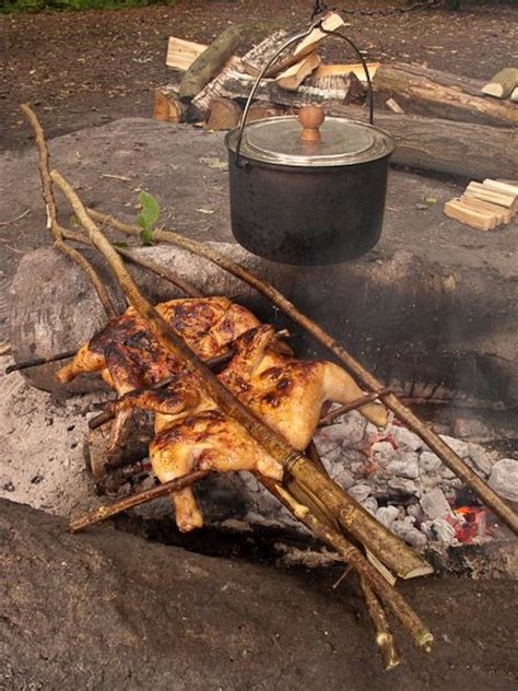 cfire cooking ponassed chickens cooking on an open fire http www ravenlore co uk html cooking html